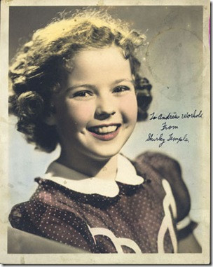 "Hand-colored studio portrait of Shirley Temple with handwritten inscription: ""To Andrew Worhola [sic] from Shirley Temple"""